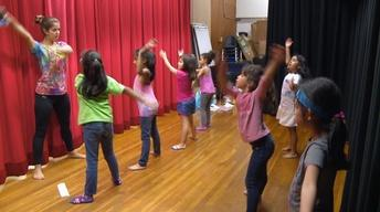 Young Girls Learn a New Language Through Dance