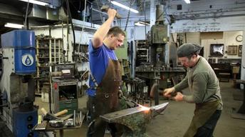 Blacksmiths Arnon Kartmazov and Nitzan Lilie Striking