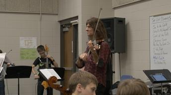 Rock Violinist Mark Wood Works With Middle School Strings