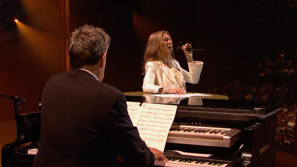 "Celine Dion sings ""Because You Loved Me"" image"