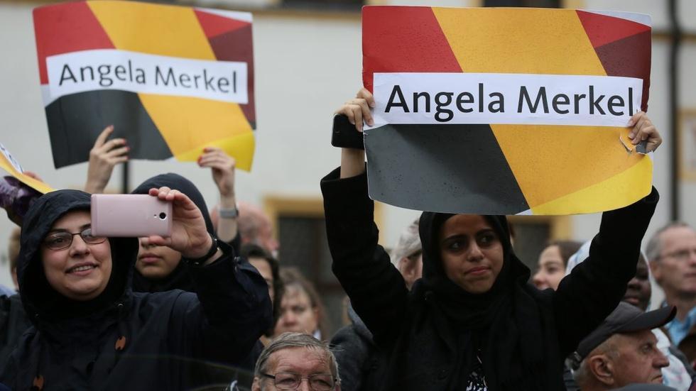 Merkel beating backlash to refugee policy in reelection bid image