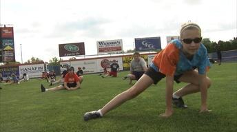 Hannah Takes a Swing at the B-METS Baseball Camp