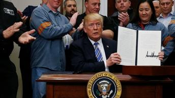 Imposing tariffs, Trump claims national security is at stake