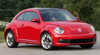 2012 Volkswagen Beetle & 2011 Saab 9-5