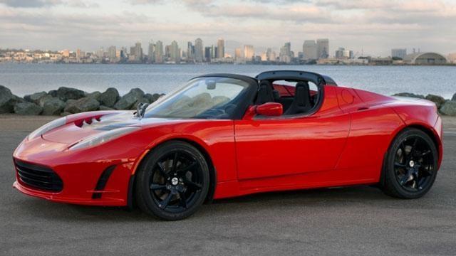 2011 Tesla Roadster 2.5 & 2011 Infiniti QX56 image