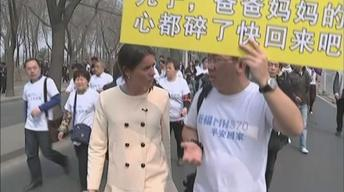 News Wrap: Relatives of Flight 370 passengers hold protest