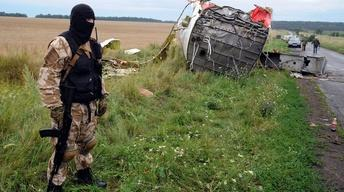 MH17 crash in war zone poses security challenges