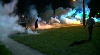 Images of Ferguson confrontations resonate around U.S.