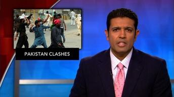 News Wrap: Mob attacks convoy of Pakistan opposition figure