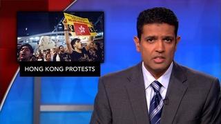 News Wrap: Hong Kong protesters boo Chinese flag