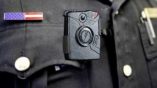 Making body cameras part of a police officer's uniform