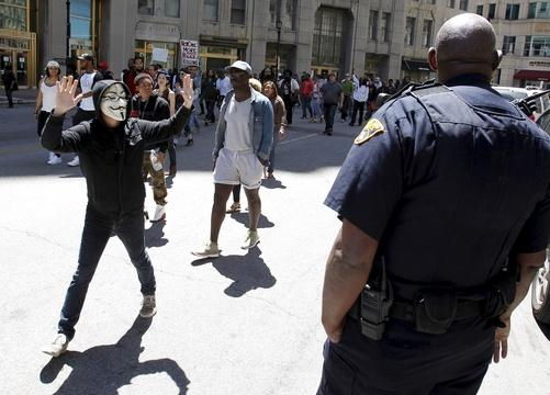 Protests simmer, but Cleveland calm after cop's acquittal