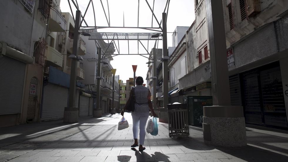 Puerto Rico debt crisis drives exodus to U.S. image