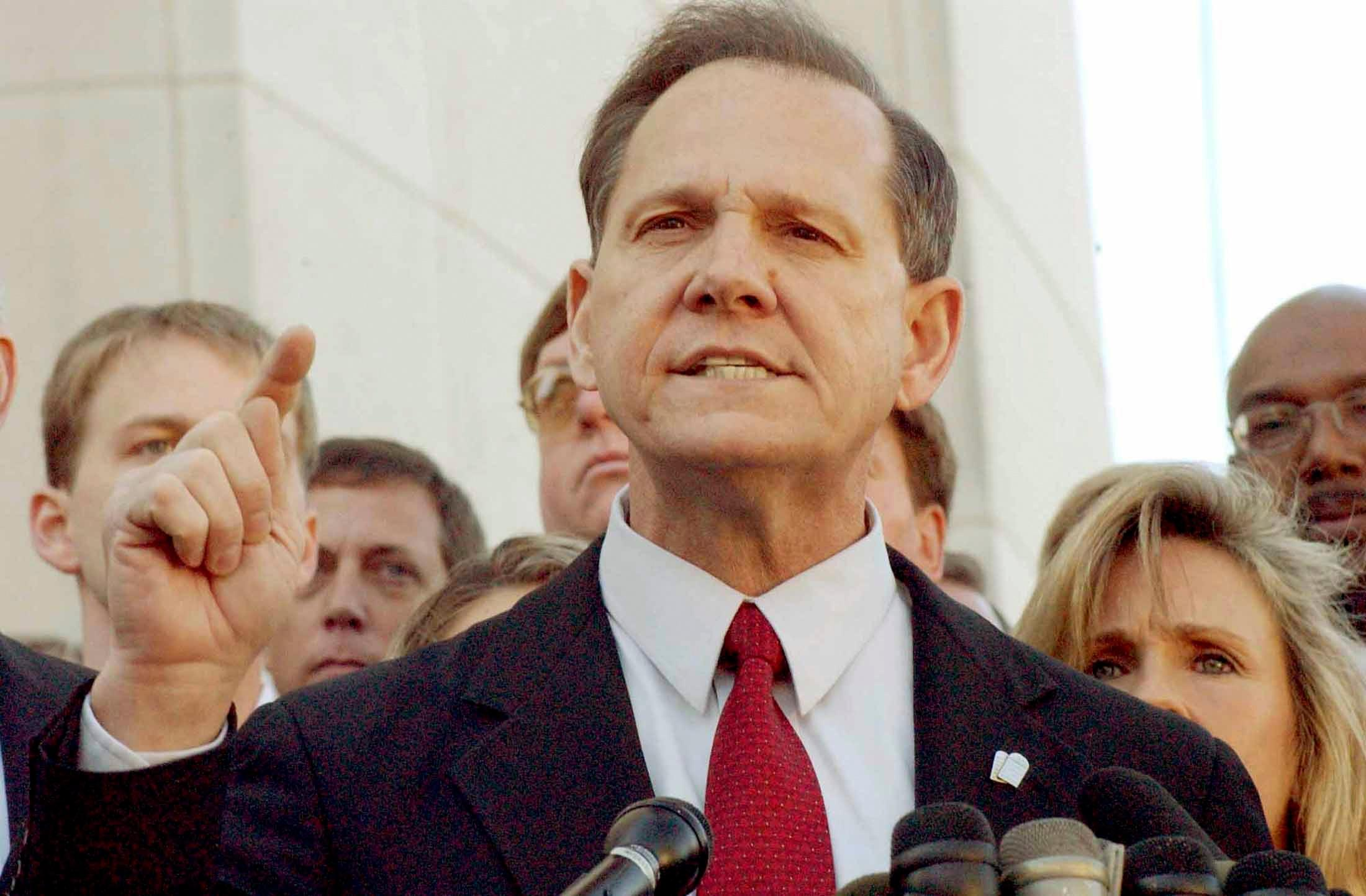 News Wrap: Alabama justice banned over gay marriage licenses