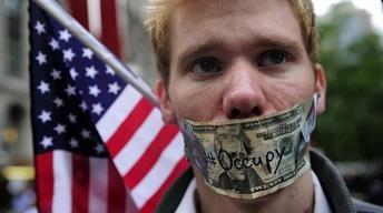 Wall Street Protests Spread, Channeling Anger at...