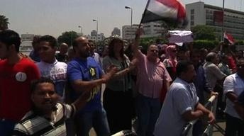 Egyptians Praise, Protest Installation of Interim President