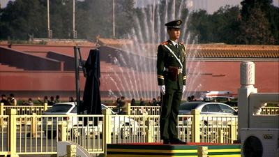 soldier standing at attention in Tiananmen Square