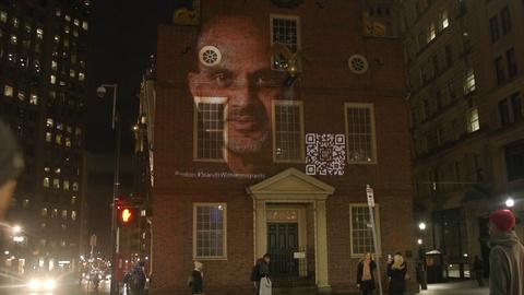 PBS NewsHour -- Landscape-sized portraits of immigrants light up Boston