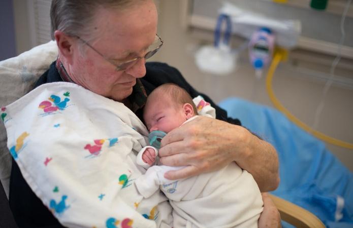 Retired Adults Volunteer as Baby Cuddlers
