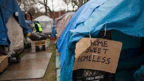 Image of Residents react as their tent city is dismantled