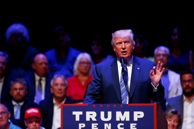 Trump visits Democratic stronghold, trails in key polls