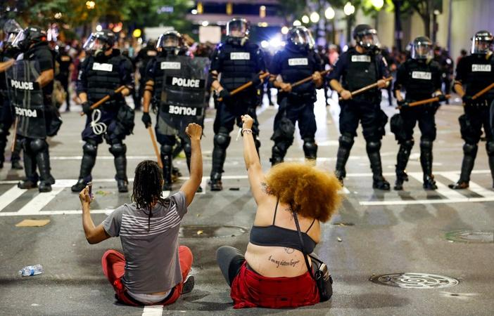 Soldiers stand in Charlotte's streets amid police protests