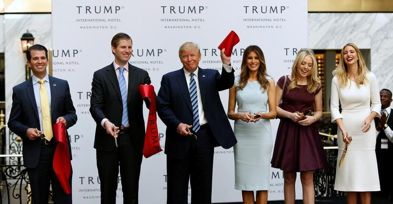 Candidates use Trump's new hotel as election metaphor