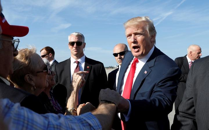 News Wrap: Back in campaign mode, Trump touts jobs at Boeing