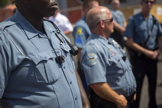 How can Ferguson law enforcement break a pattern of bias?