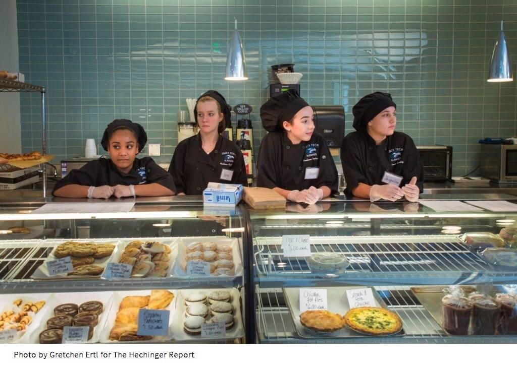 Freshmen in the Culinary Arts program wait for customers at the bakery counter