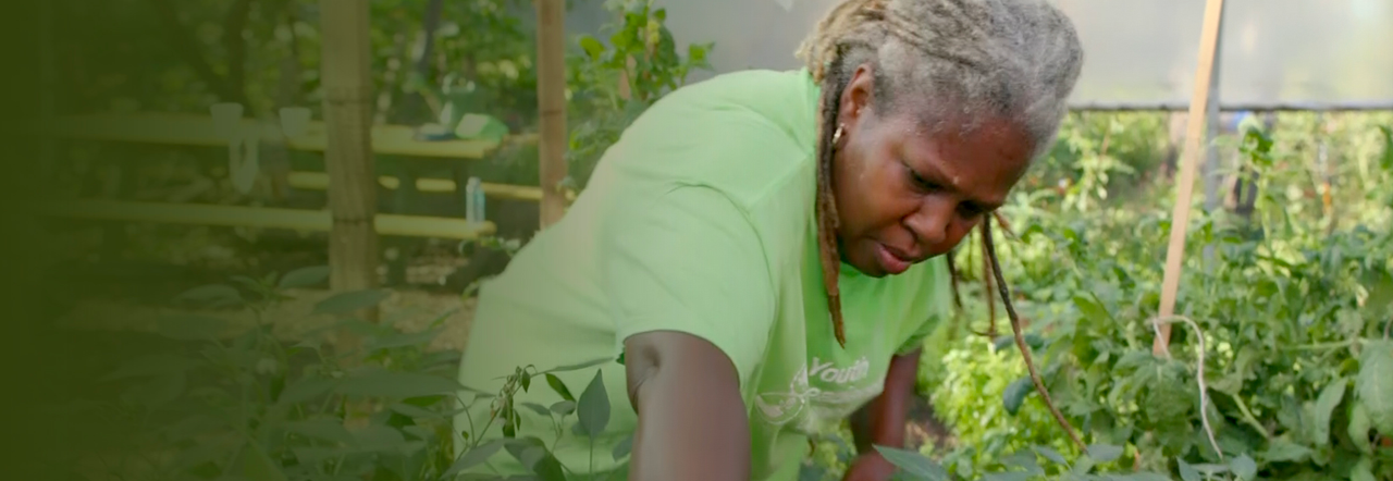 Karen Washington works in her vegetable garden