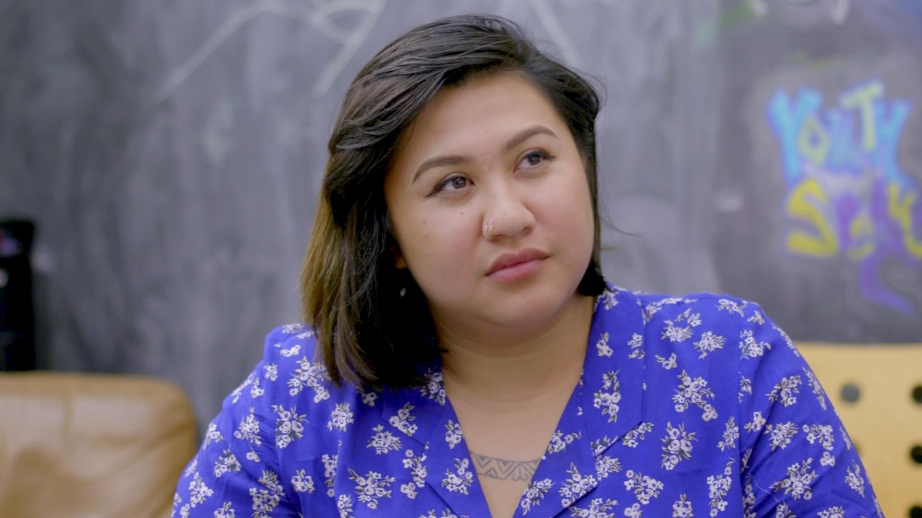 Portrait of Gretchen Carvajal in a blue print dress