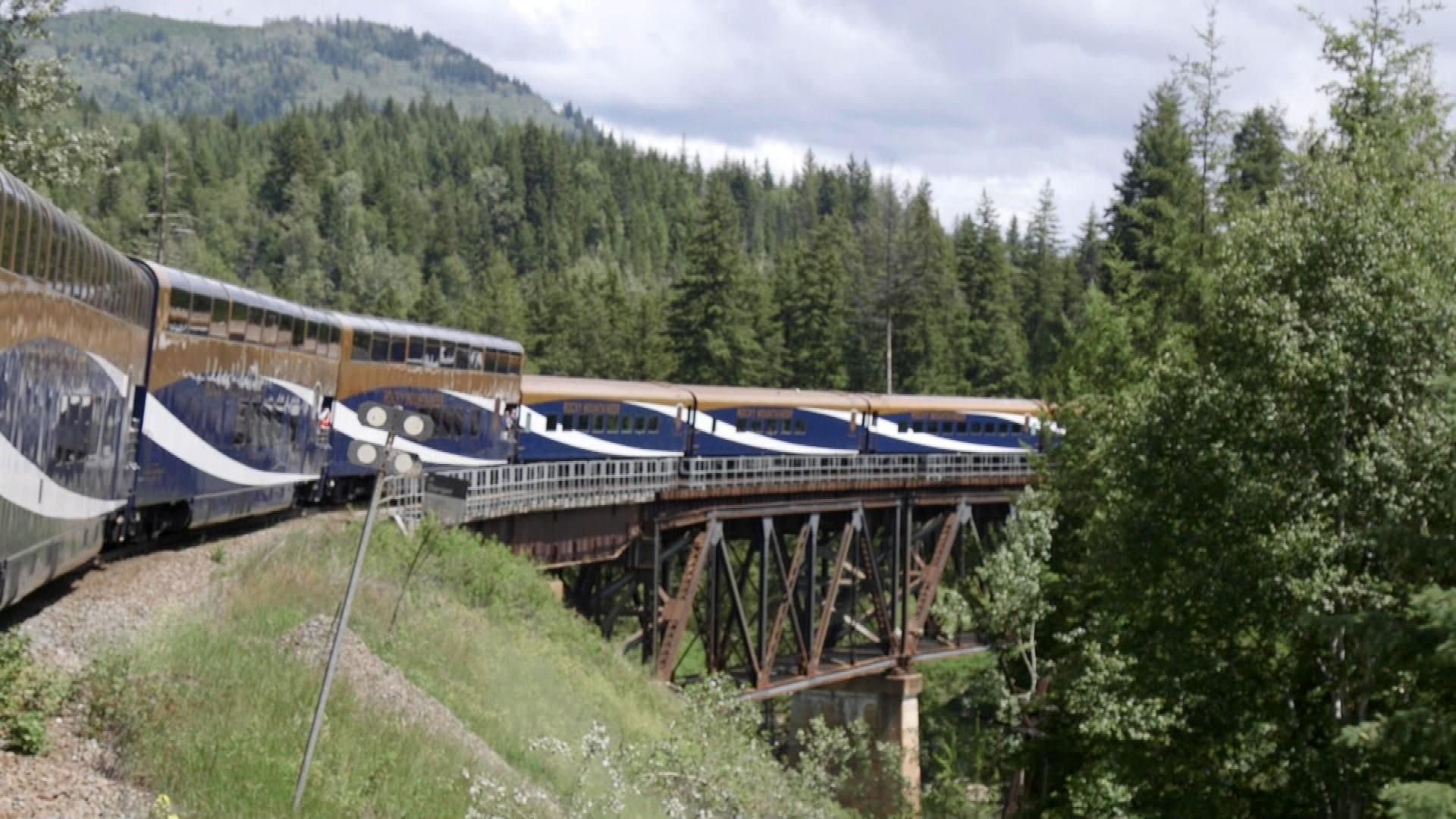 Rocky Mountaineer traveling over bridge