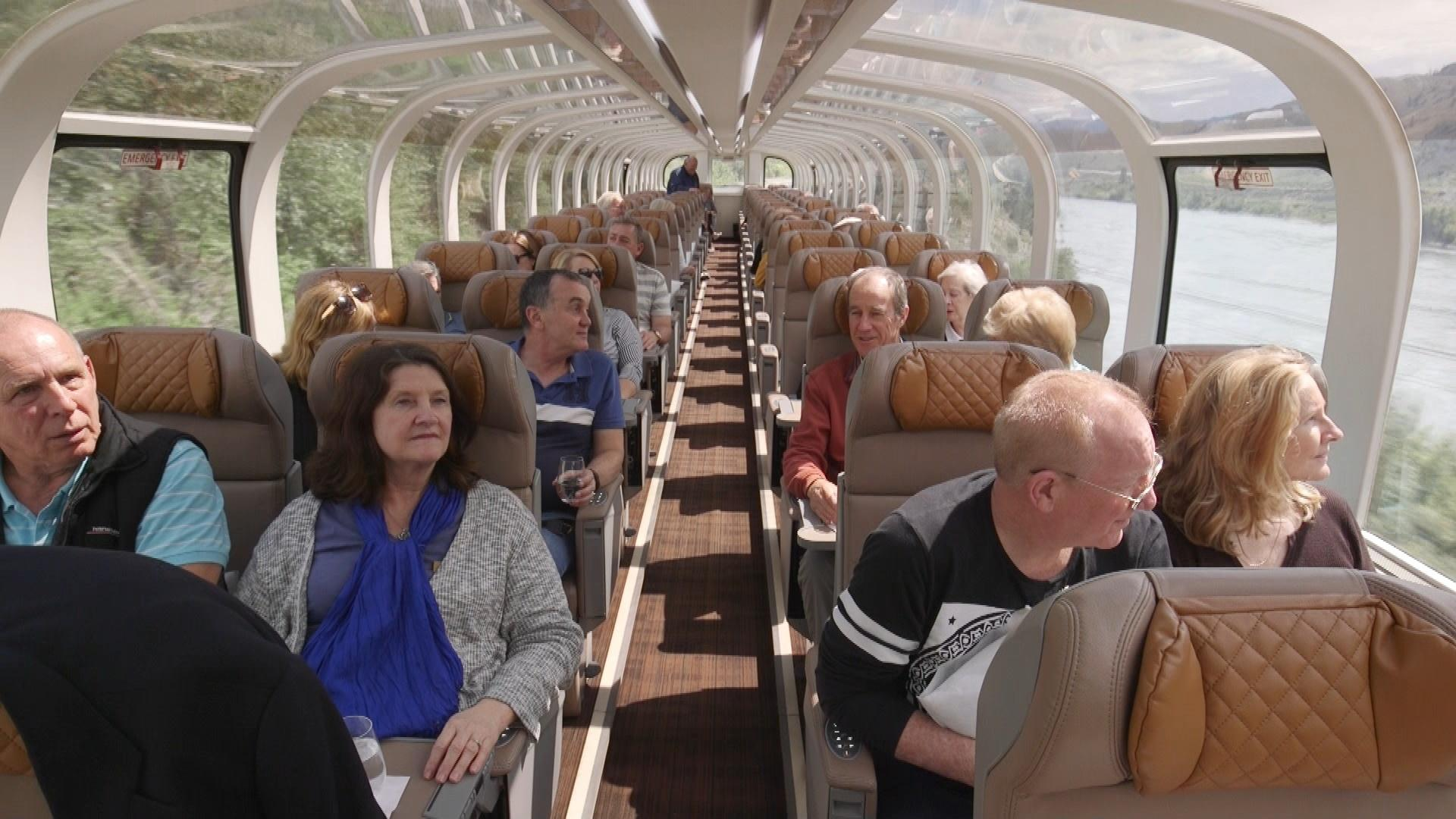 Passengers aboard the Rocky Mountaineer on they way to Kamloops