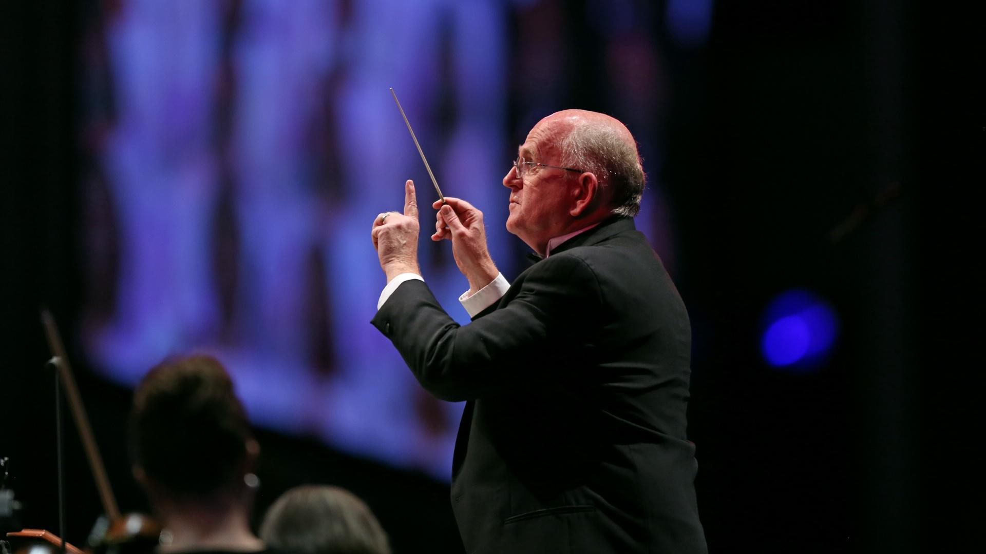 Dr. Mack Wilberg of The Tabernacle Choir conducts musicians.