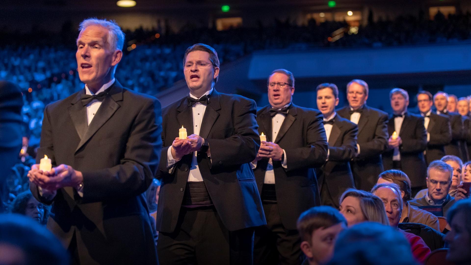 Male members of The Tabernacle Choir singing.
