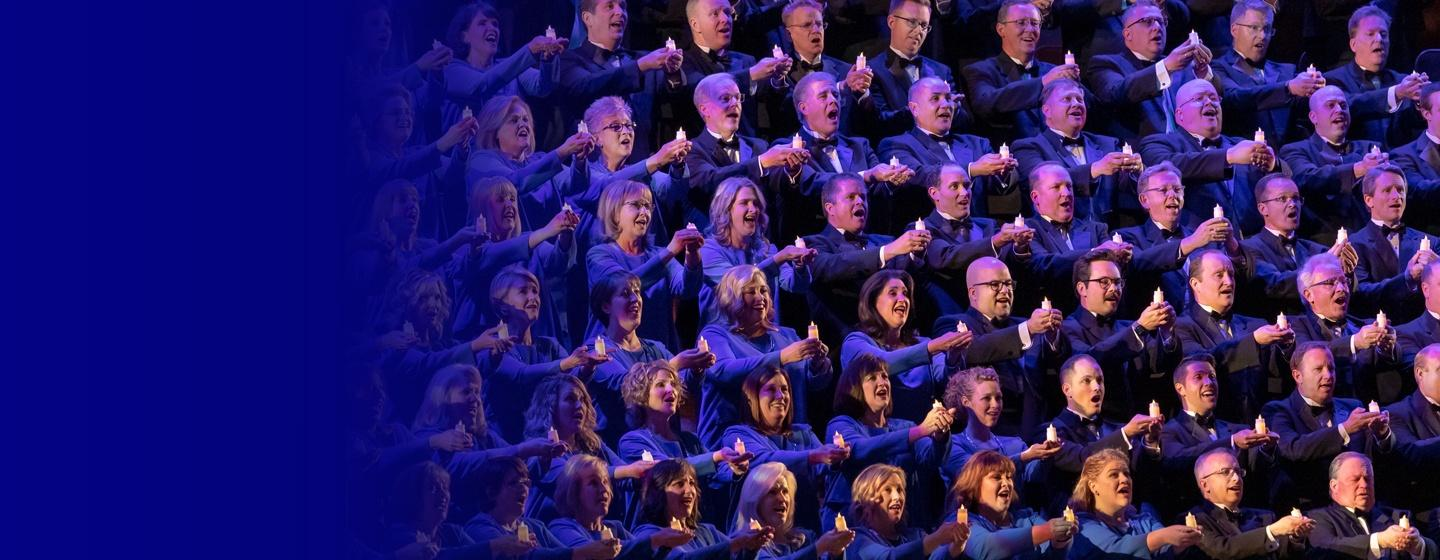 The Tabernacle Choir hold candles and sing