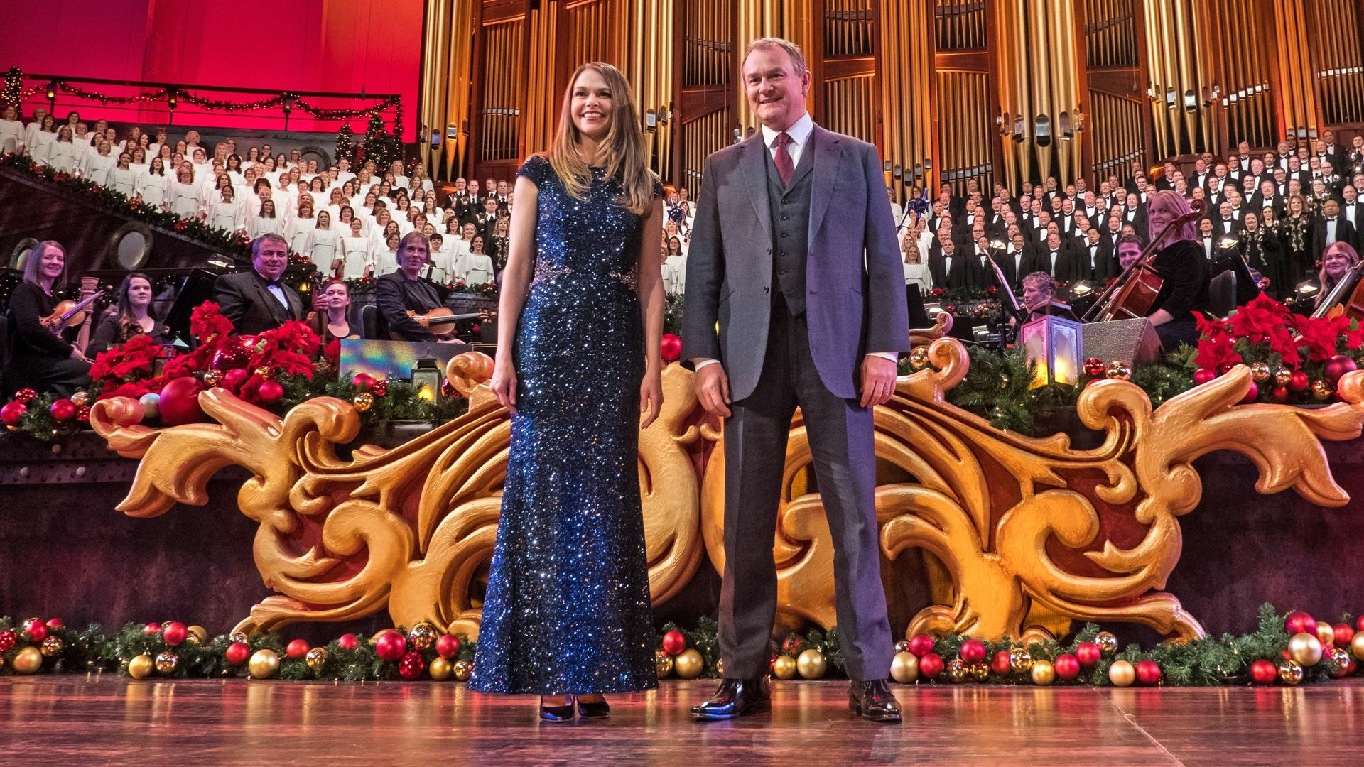With the large organ in the background, Mack Wilberg stands among The Orchestra at Temple Square and The Tabernacle Choir.
