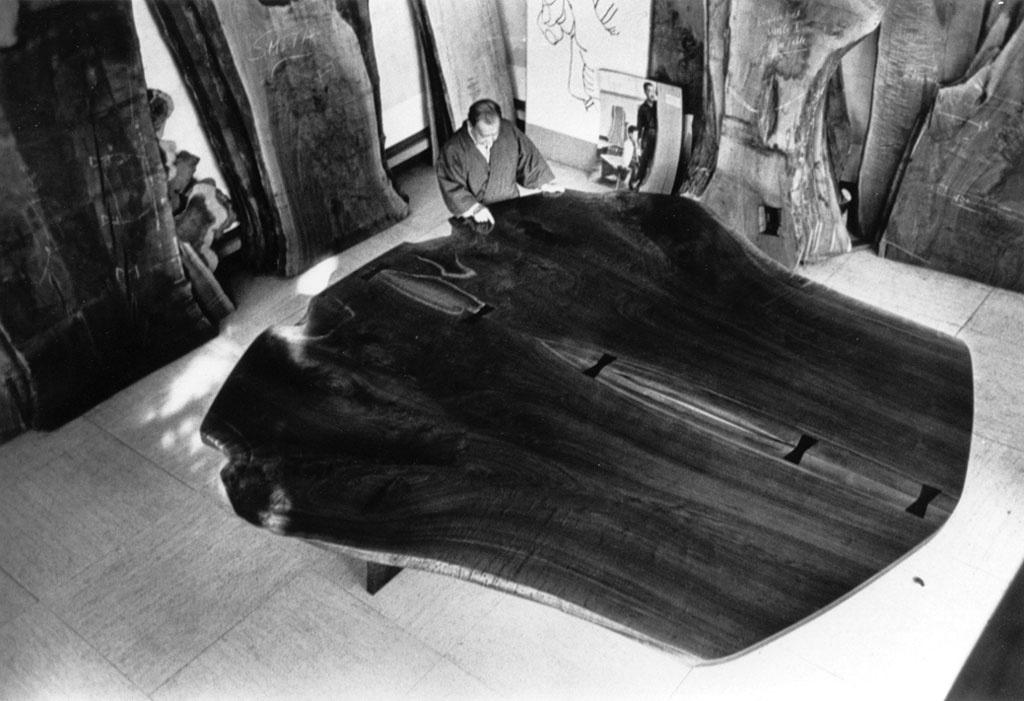 GEORGE NAKASHIMA WITH HIS PEACE TABLE.
