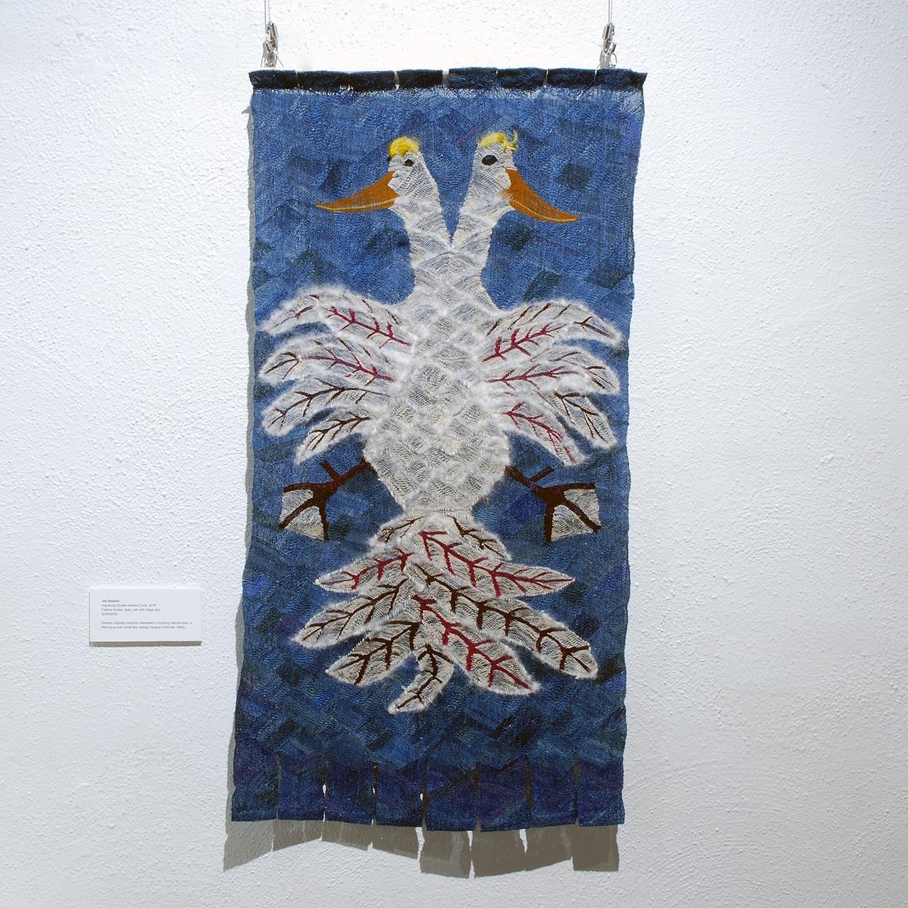 """Objects, Borders and Neighbors, Jim Bassler, """"Hapsburg Double Headed Duck"""", Feather yarn, indigo-dye, 2016"""