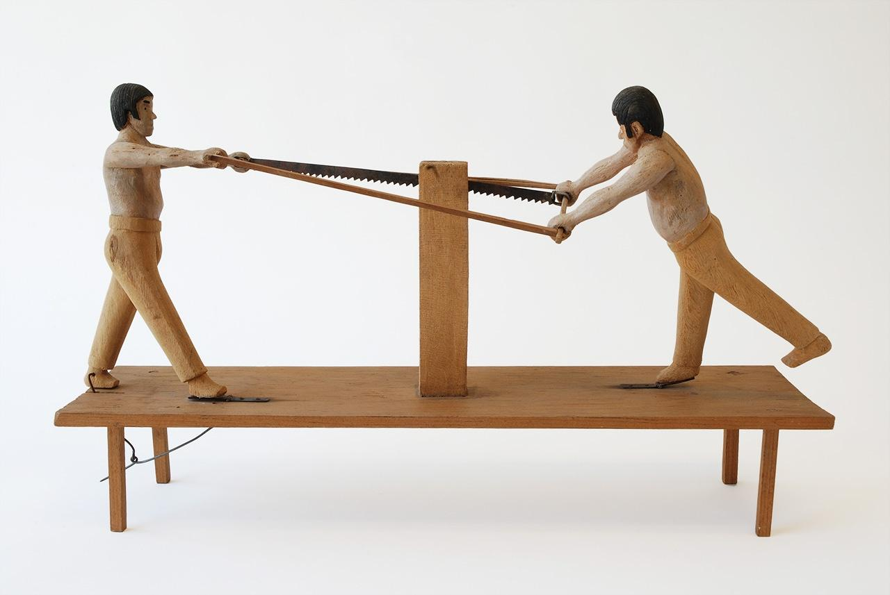 "Objects, Borders and Neighbors, Unknown artist, ""Two men sawing wood"", wood, paint, metal, Jim and Veralee Bassler Collection"