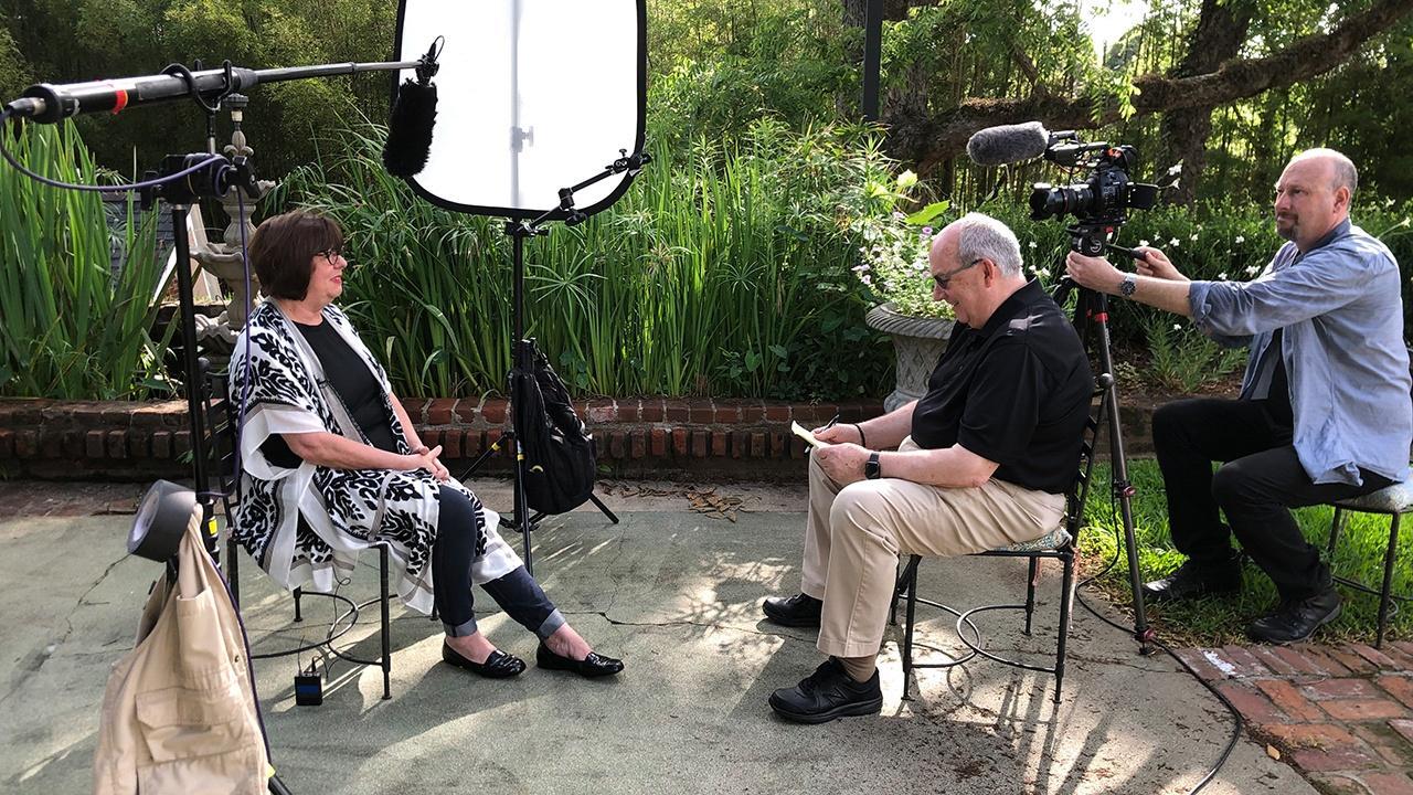 camera crew set up to interview Regina Charboneau
