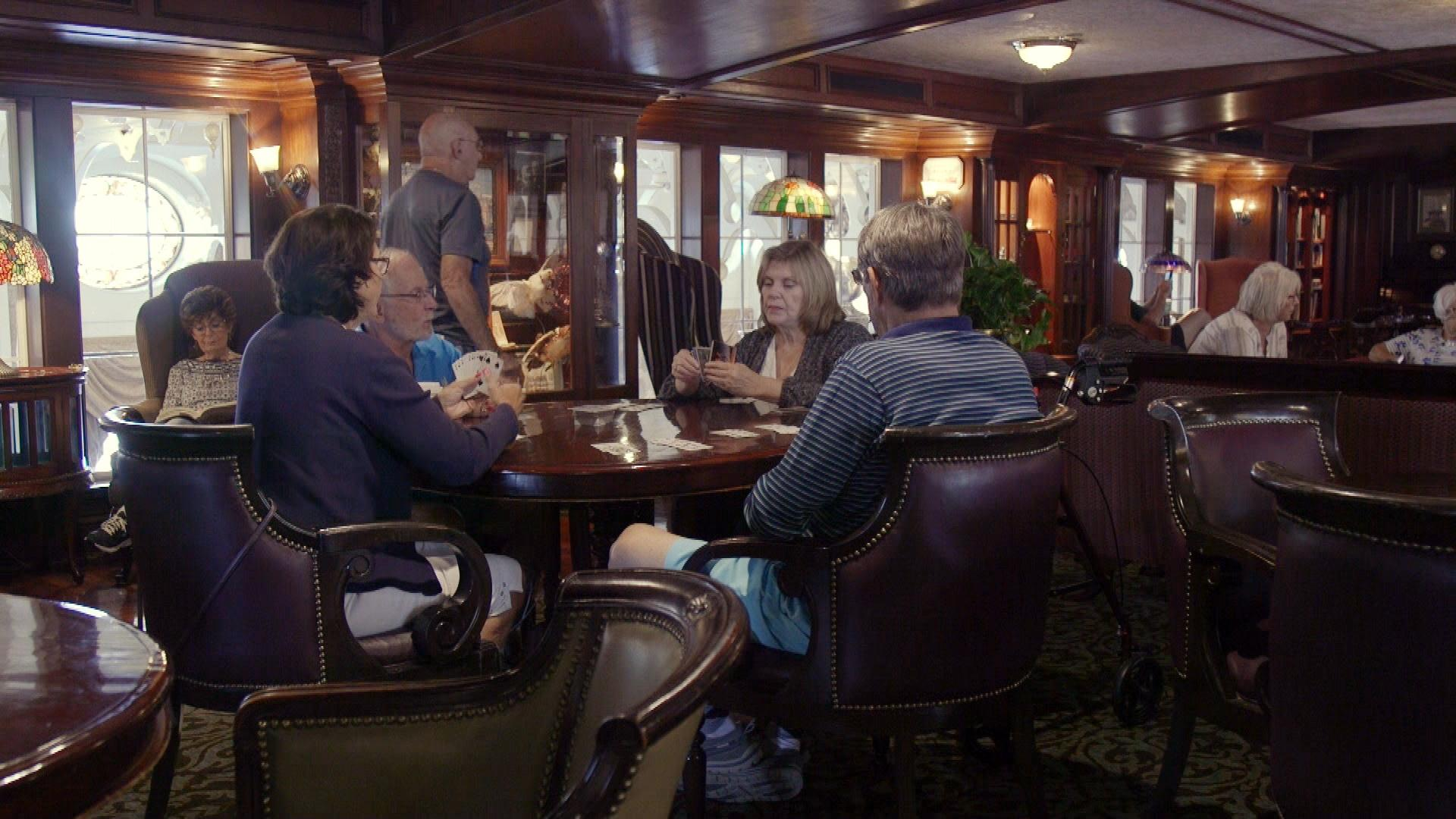 guests playing cards in the lounge aboard the American Queen