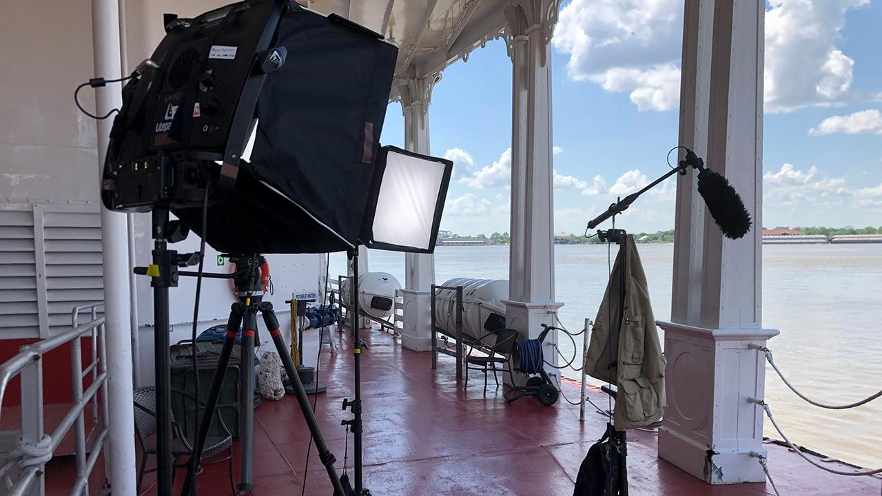 Lighting and sound gear set up for an interview on the deck of the American Queen