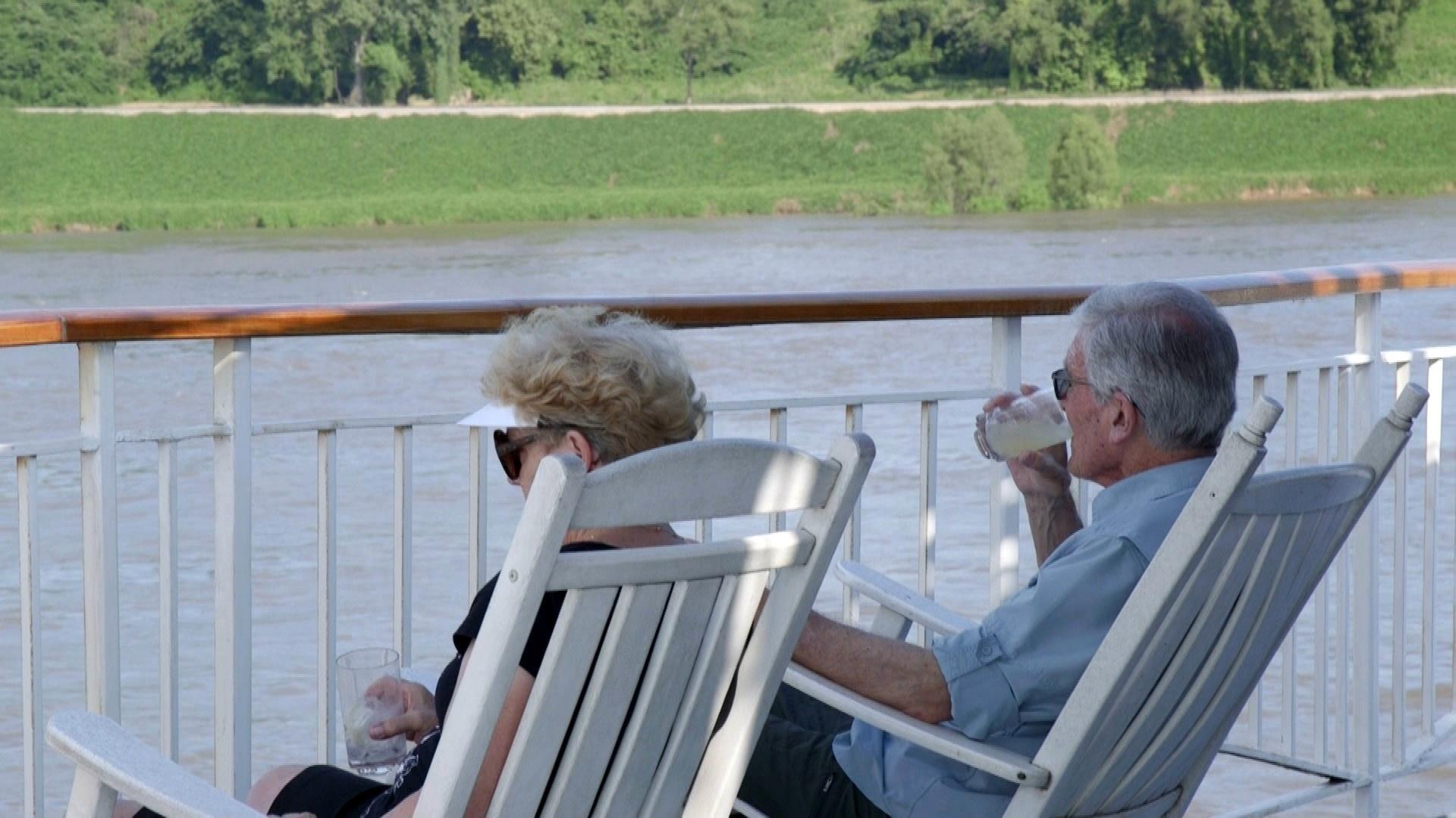 2 guests on deck of the American Queen