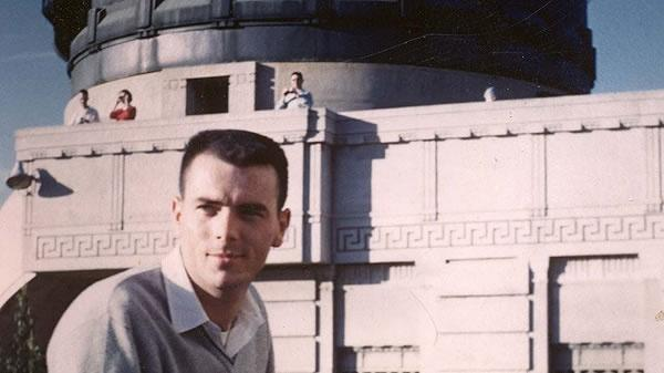 a man, Gary Flandro, in front of an observatory