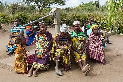 Women around water pump built by Gorongosa Restoration Project - photo by Katherine Jones