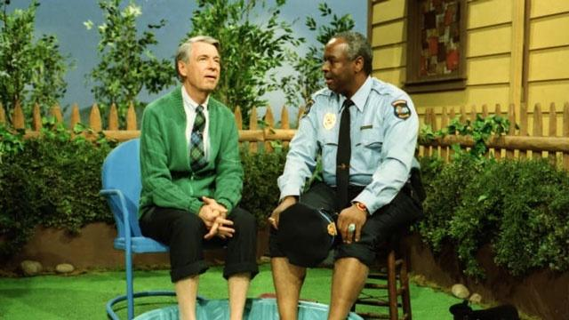 Mister Rogers sitting with Officer Clemmons