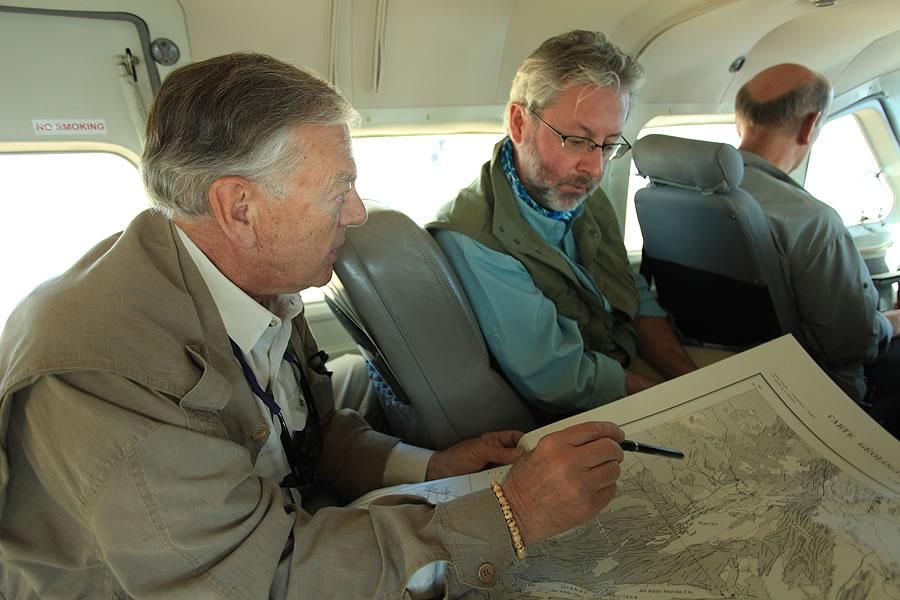 Donald Johanson and Neil Shubin looking at a map