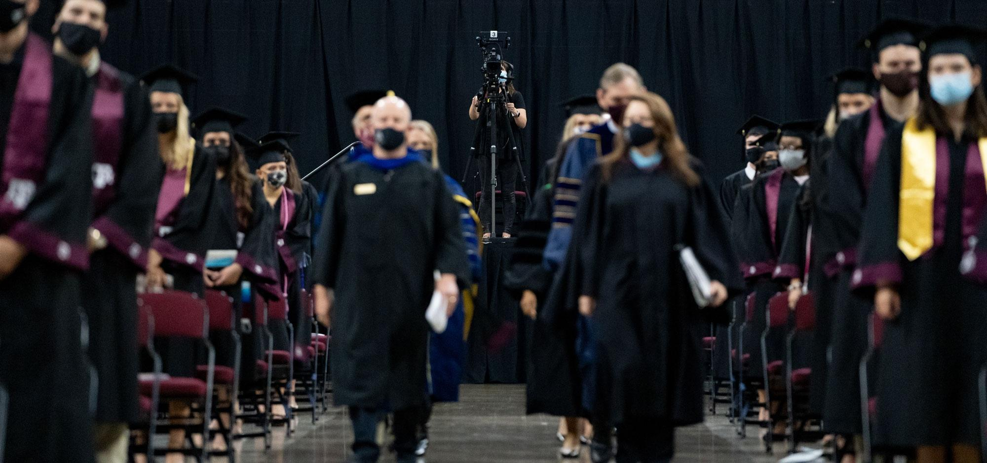 graduates walking down the aisle at the commencement ceremony